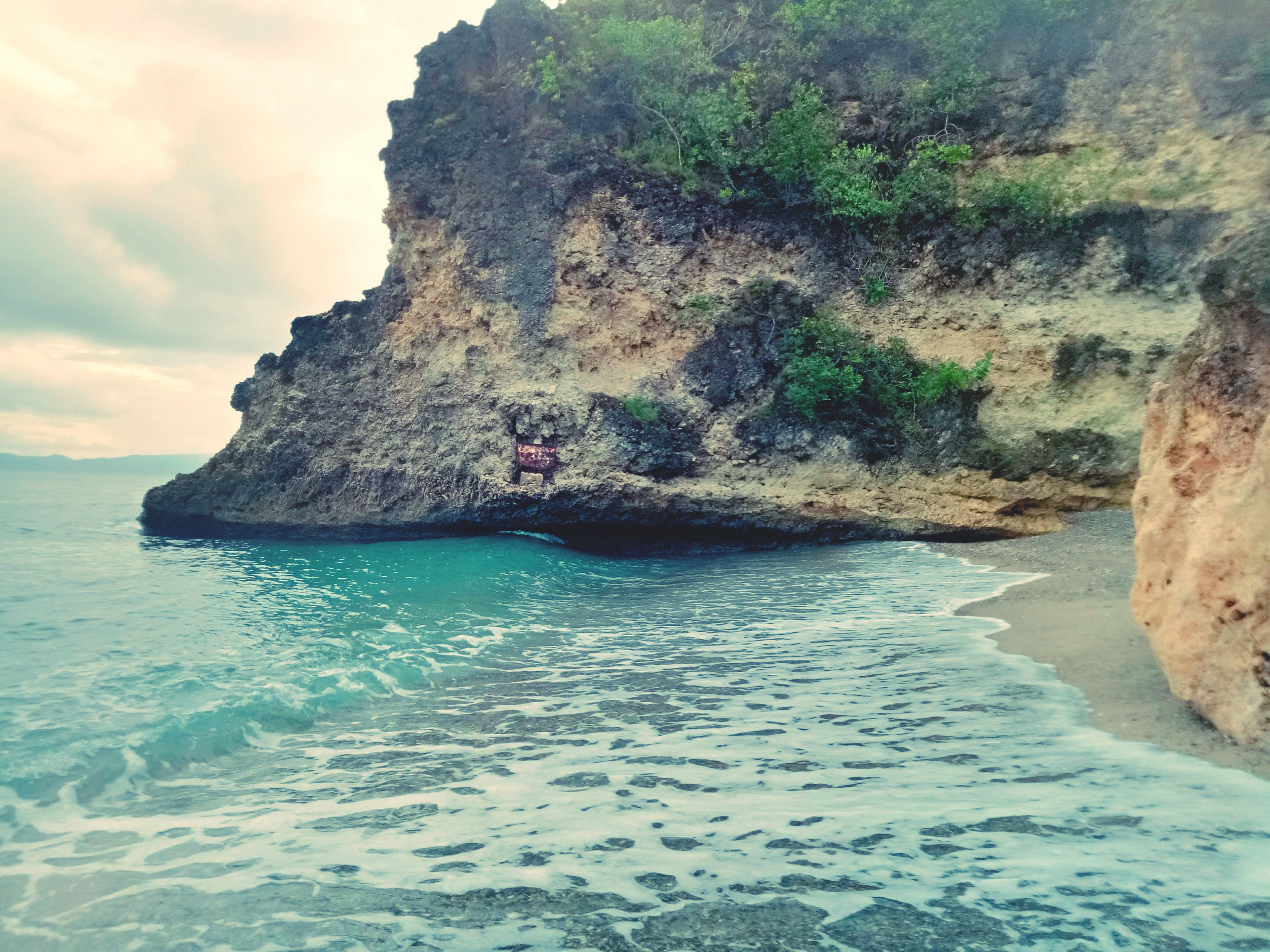 sea, nature, water, beauty in nature, rock formation, rock - object, scenics, tranquility, tranquil scene, no people, sky, outdoors, cliff, day, beach, horizon over water