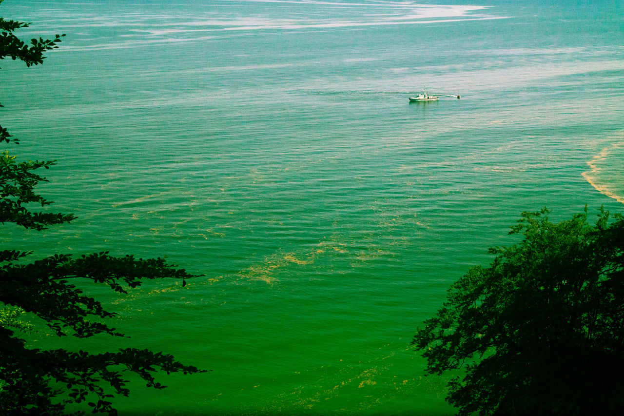 Beauty In Nature Boat On Sea Calm Green Color Green Sea High Angle View Non-urban Scene Sea Seascape Water Waterfront