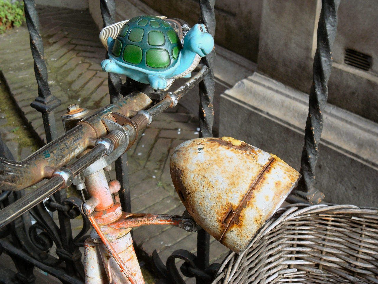 Recycling Of A Squeaky Toy As A Bicycle Bell Bicycle Bicycle Basket Bicycle Parking Bicycle Rack Day Land Vehicle Mode Of Transport No People Outdoors Rusted Rusty Bicycle