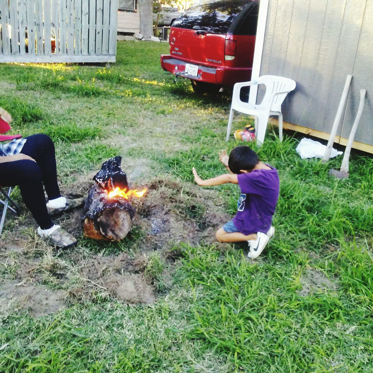 real people, grass, burning, flame, outdoors, field, full length, day, one person, leisure activity, men, boys, lifestyles, childhood, nature, building exterior, architecture