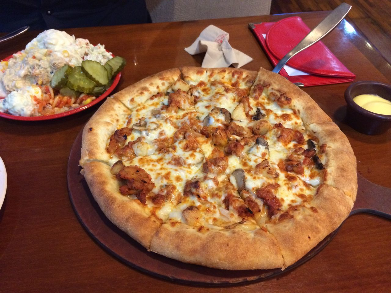 High Angle View Of Pizza Served On Table At Restaurant