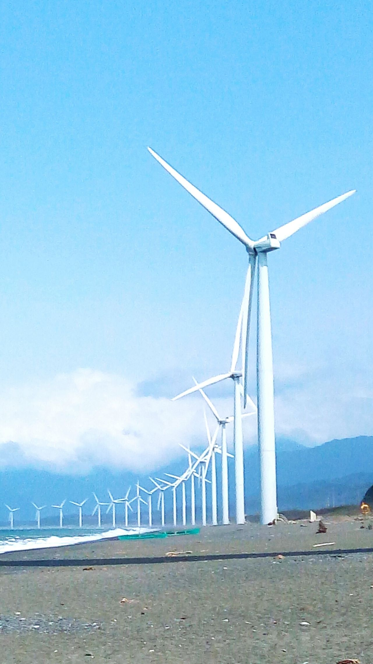 No People Wind Power Wind Turbine Alternative Energy Sky Renewable Energy Nature Day Outdoors Clouds Relax Blue Clouds And Sky Cloudy Skies Clouds & Sky Cloudscape Sea Travel Having A Good Time Vacations Sea And Sky Scenics Beauty In Nature Sunlight