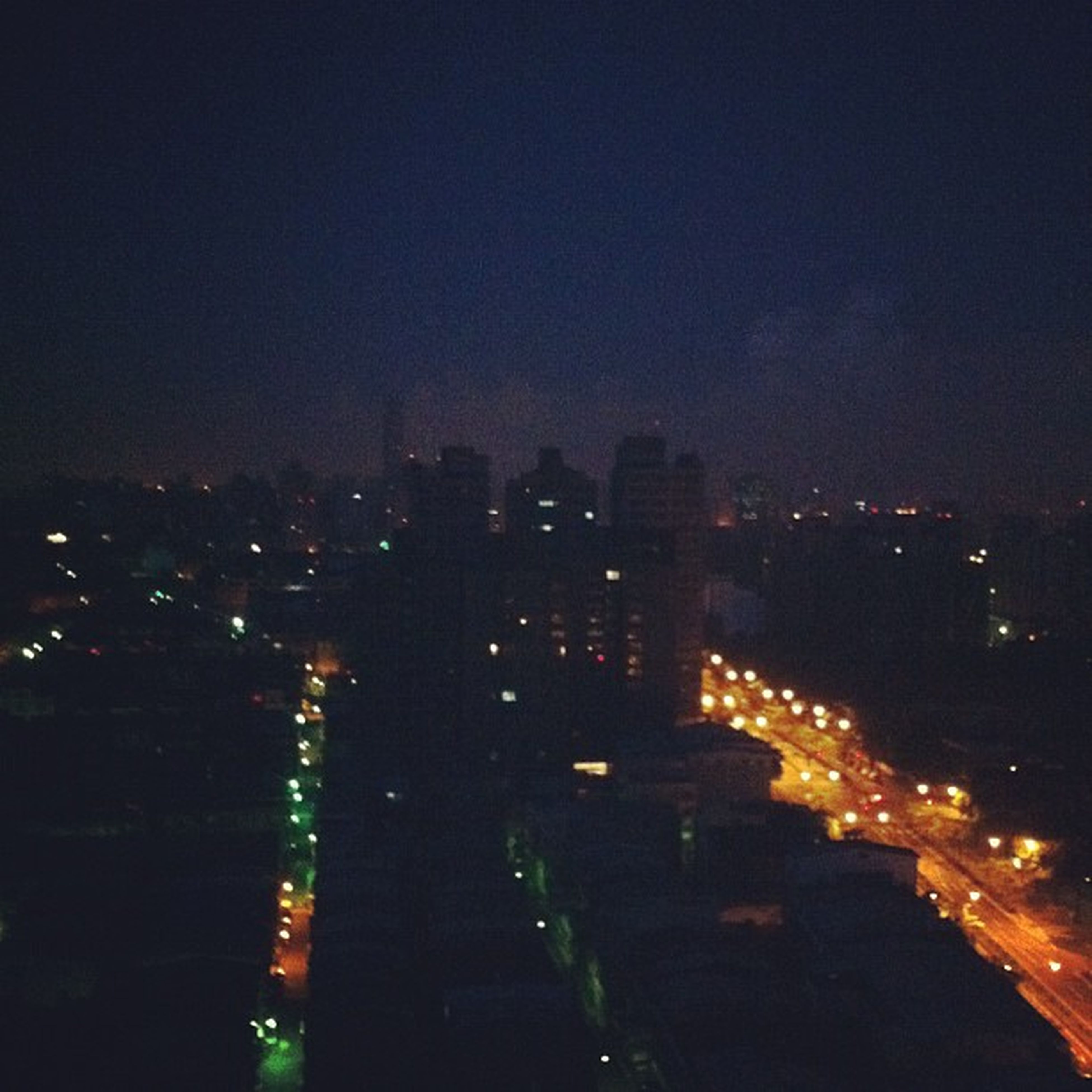 illuminated, night, city, cityscape, building exterior, architecture, built structure, skyscraper, crowded, sky, modern, tall - high, tower, high angle view, city life, office building, capital cities, residential district, urban skyline, copy space