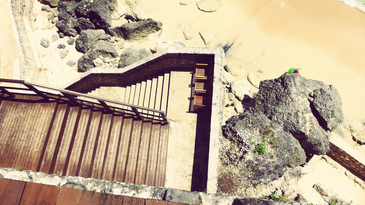 High Angle View Of Empty Steps At Sandy Beach