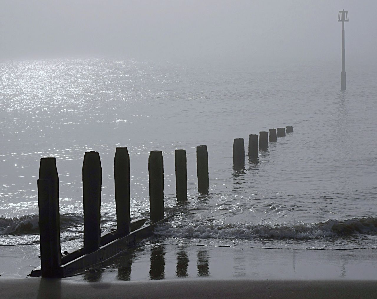 water, sea, nature, weather, wooden post, outdoors, cold temperature, tranquility, beauty in nature, day, fog, winter, no people, scenics, beach, horizon over water, sky