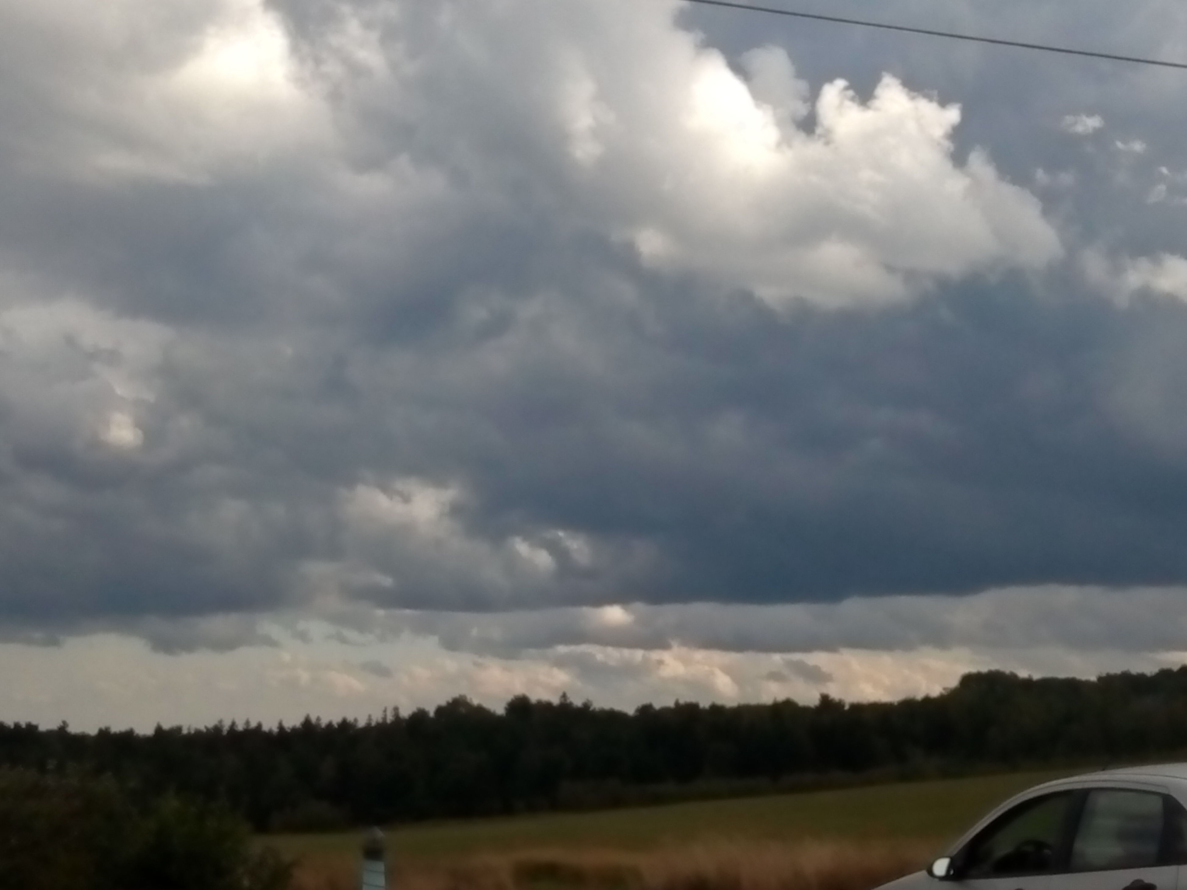 transportation, road, cloud - sky, sky, car, tranquil scene, cloudscape, the way forward, cloud, mode of transport, tranquility, cloudy, scenics, nature, day, solitude, non-urban scene, outdoors, beauty in nature, atmospheric mood, countryside, majestic, cumulus cloud, storm cloud, country road, ominous