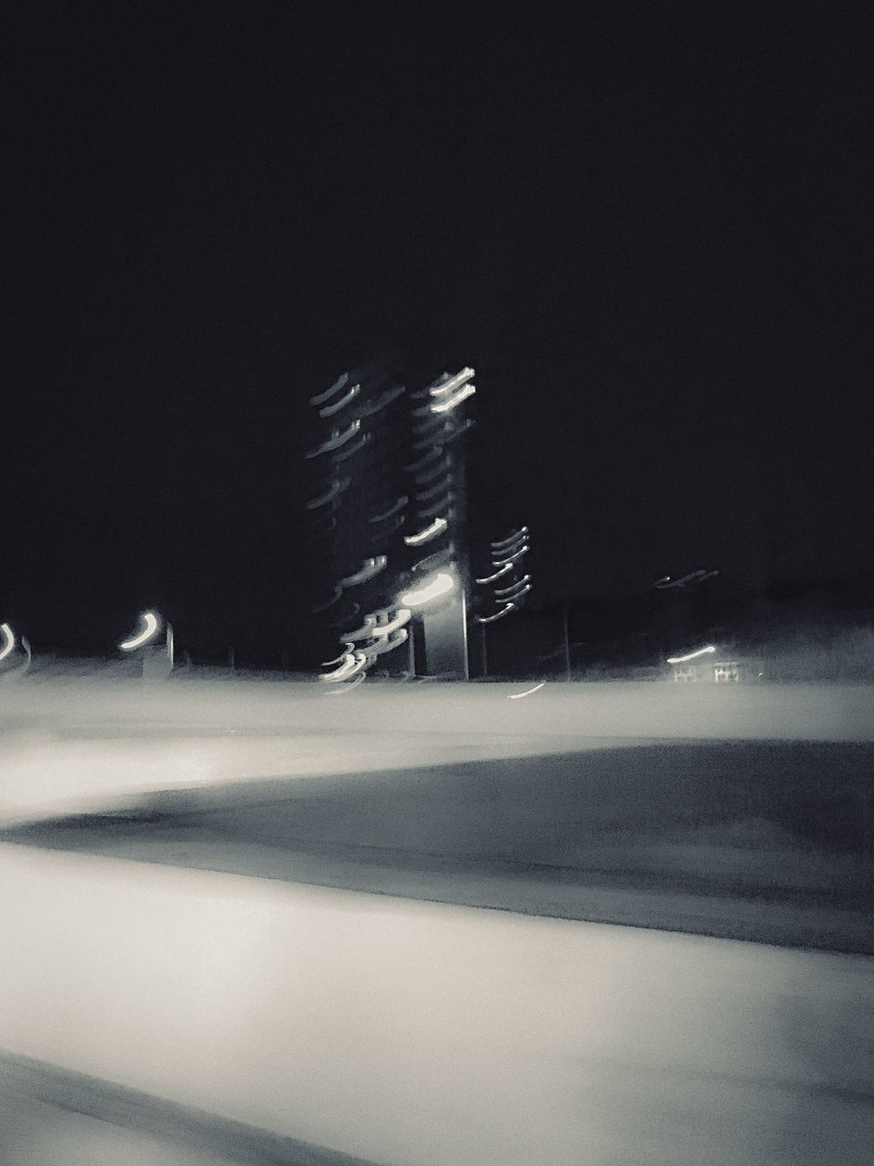 night, long exposure, motion, illuminated, speed, blurred motion, light trail, winter, outdoors, cold temperature, clear sky, no people, road, nature, snow, scenics, sky, city, high street, building exterior, architecture