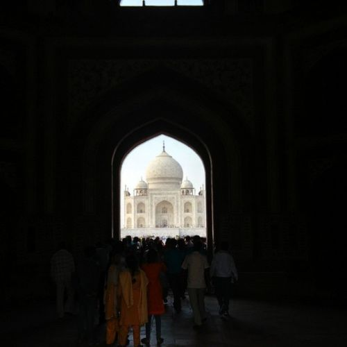 "The first sight of the Tajmahal thru the entrance gate which is inscribed with ""inviting visitors into paradise"" Agra Architecture Shahjahan Love Nofilter Mytajmemory"