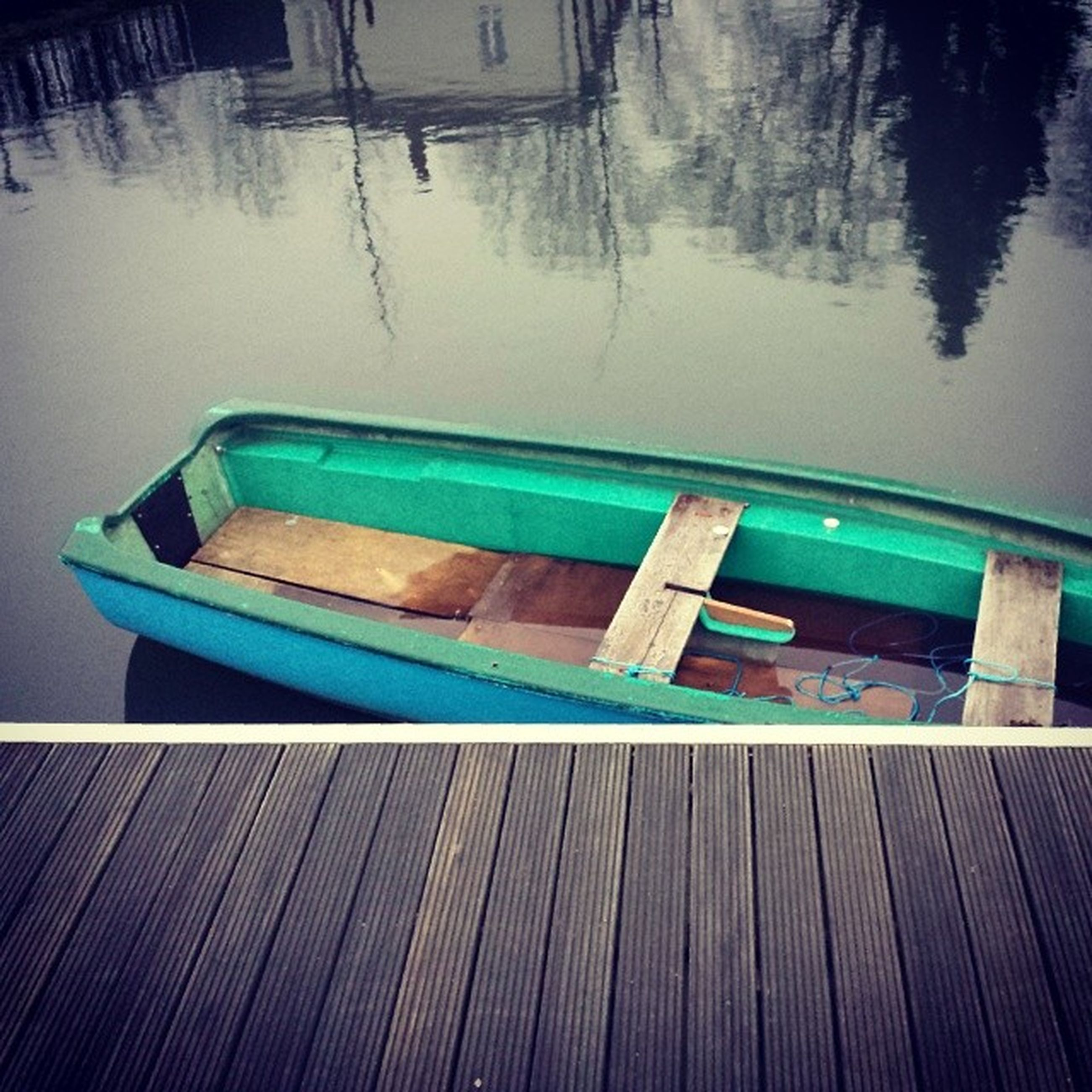 water, nautical vessel, boat, reflection, blue, moored, wood - material, no people, built structure, absence, lake, empty, transportation, high angle view, outdoors, swimming pool, day, architecture, waterfront, nature