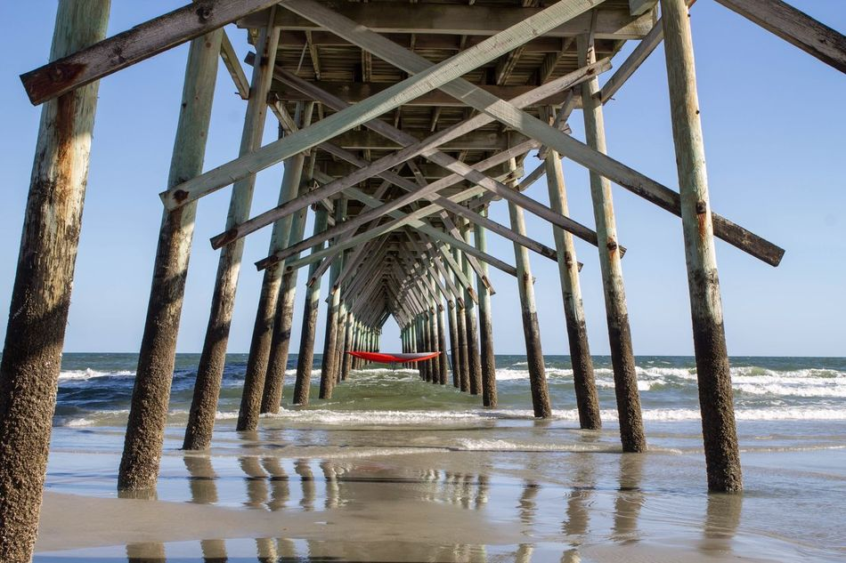 Pier Hammock Sea Water Beach Horizon Over Water Pier Underneath Day Tranquil Scene Architecture Nature Built Structure Outdoors Below Tranquility Sand Scenics No People Sky Architectural Column Beauty In Nature The Secret Spaces Hammock Ocean