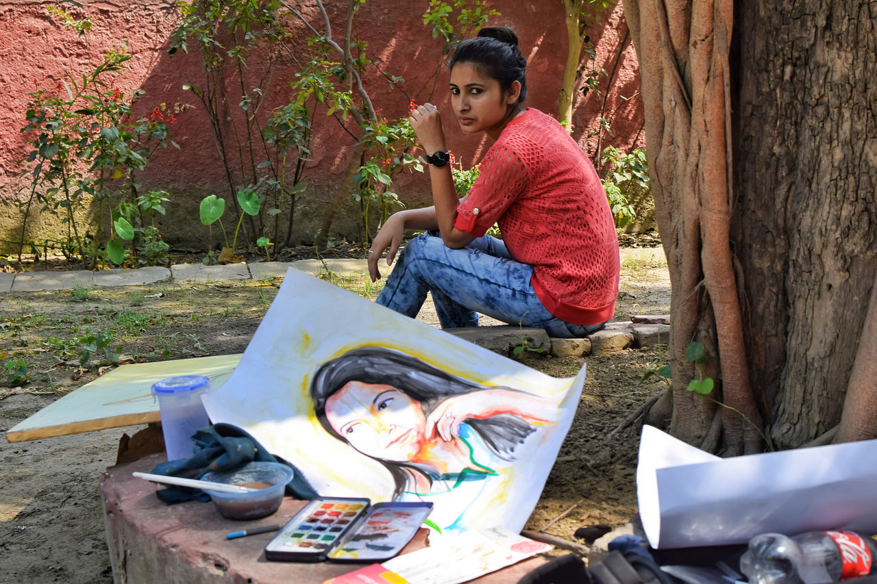 InMakin! Painting Artist Posing One Woman Only Artist Outdoors Young Women Sitting My Unique Style Bright Colors Randomness Perspective Live For The Story Place Of Heart The Street Photographer - 2017 EyeEm Awards The Photojournalist - 2017 EyeEm Awards The Portraitist - 2017 EyeEm Awards