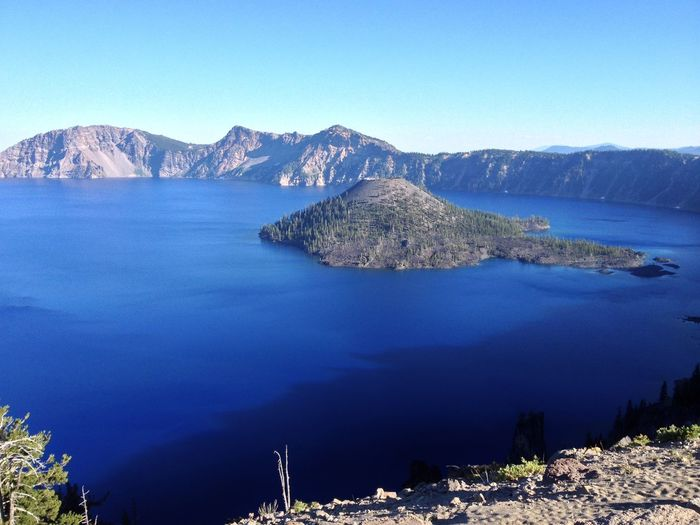 Crater Lake, Oregon Crater Lake, Oregon Wizard Island, Crater Lake Beauty In Nature Blue Clear Sky Day Lake Lakeshore Landscape Mountain Mountain Range Nature No People Outdoors Rock - Object Scenics Sea Sky Tranquil Scene Tranquility Water