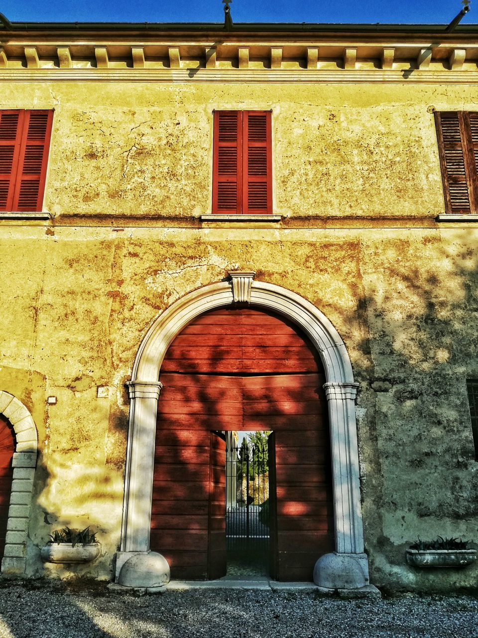 architecture, door, entrance, building exterior, built structure, window, arch, doorway, outdoors, day, entry, no people