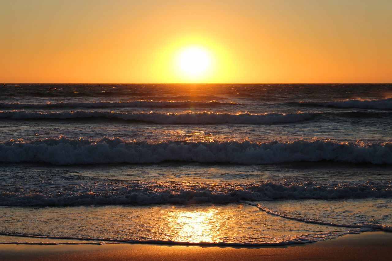 Beach Beauty In Nature Clear Sky Exceptional Photographs Horizon Over Water Nature Ocean Orange Color Orange Sky Outdoors Portugal Reflection Reflections Sand Sky Sun Sunbeam Sunlight Sunset Sunset_collection Tranquility Water Wave Waves Waves, Ocean, Nature
