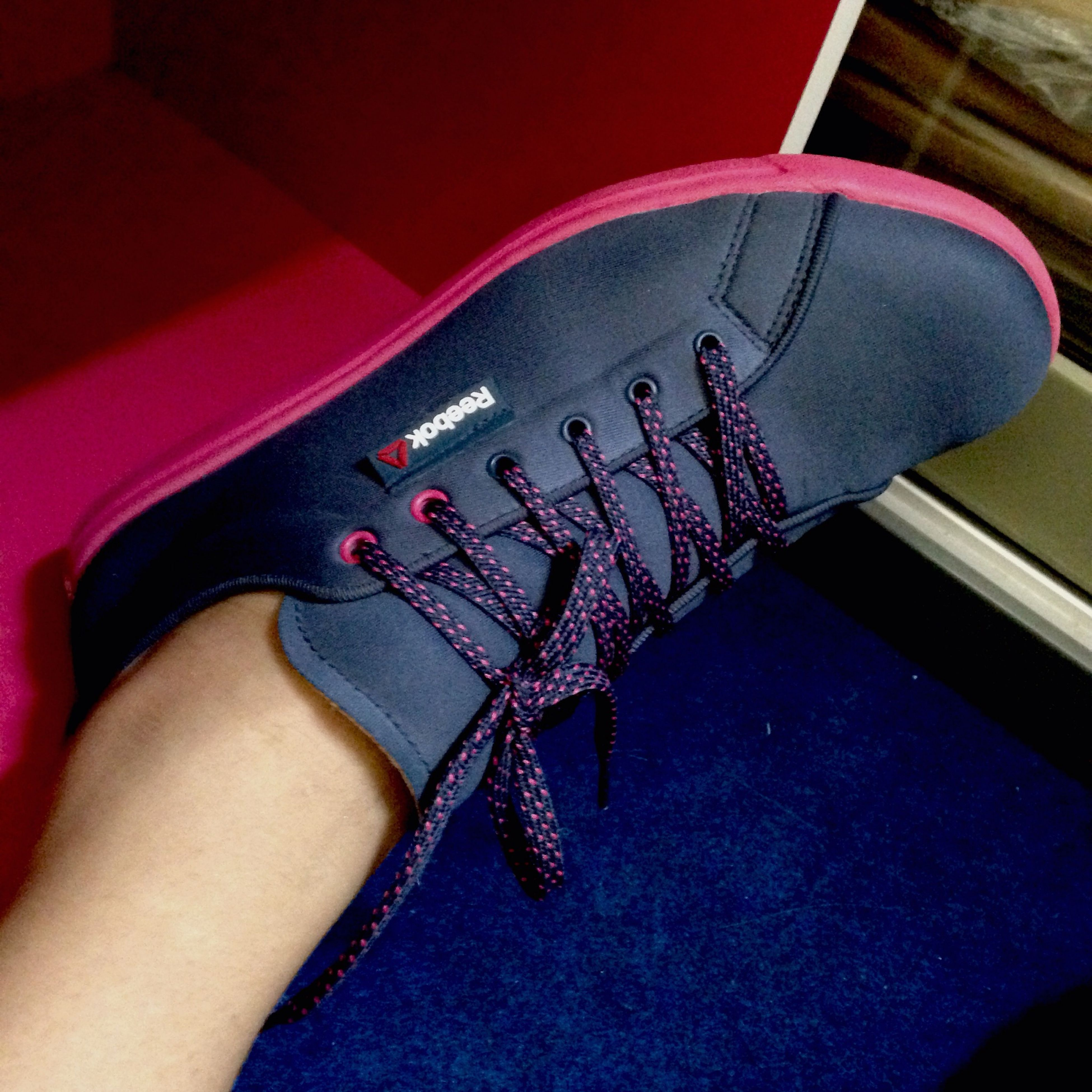 low section, person, personal perspective, indoors, lifestyles, shoe, human foot, part of, high angle view, leisure activity, footwear, jeans, fashion, text, close-up, canvas shoe