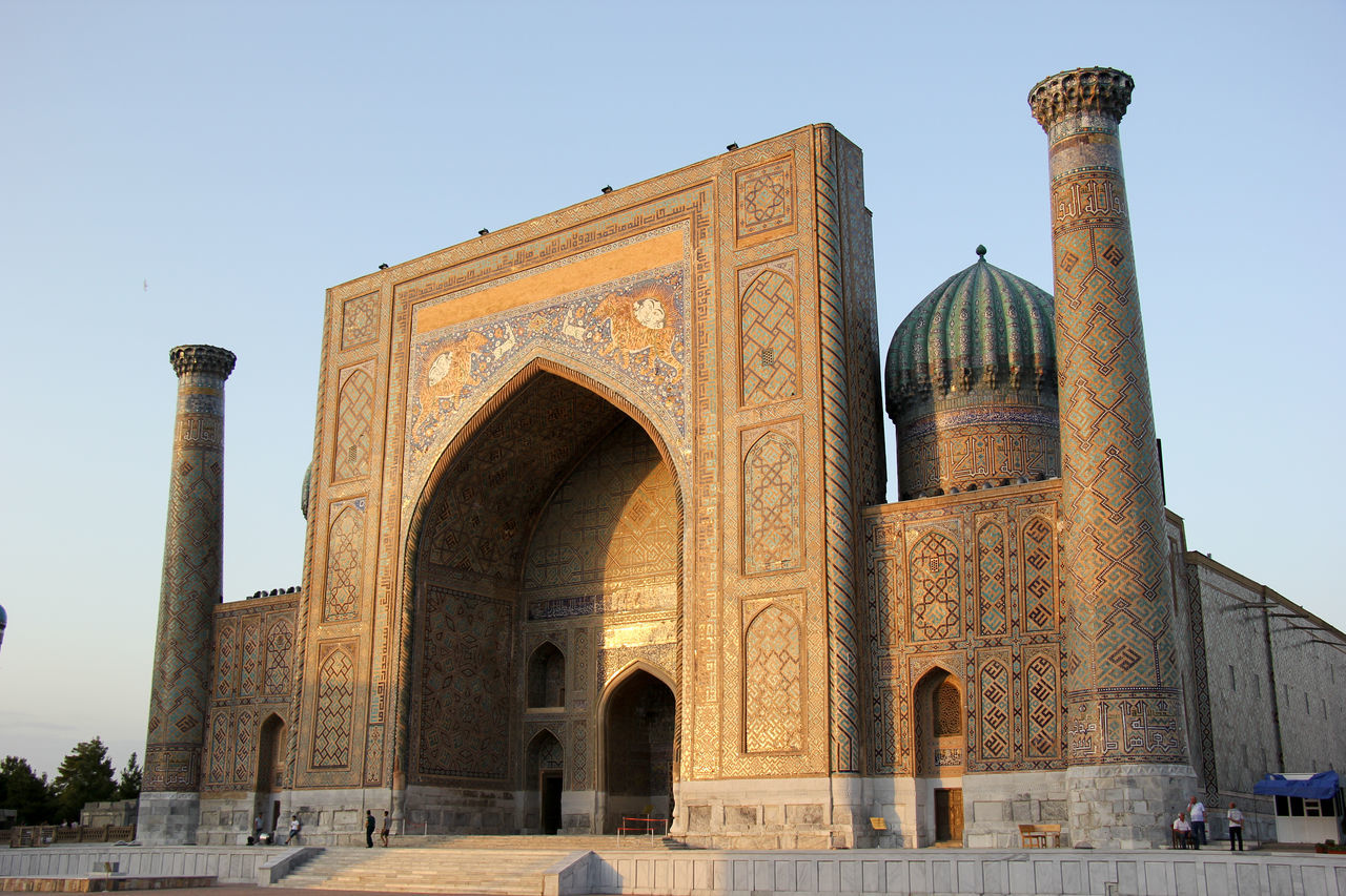 Arch Architectural Column Architecture Building Exterior Built Structure Clear Sky Day Dome History Islamic Islamic Architecture Islamic Art Low Angle View Madrassa Minarets No People Outdoors Registan Samarkand Samarqand Silk Road Sky Travel Destinations Uzbekistan