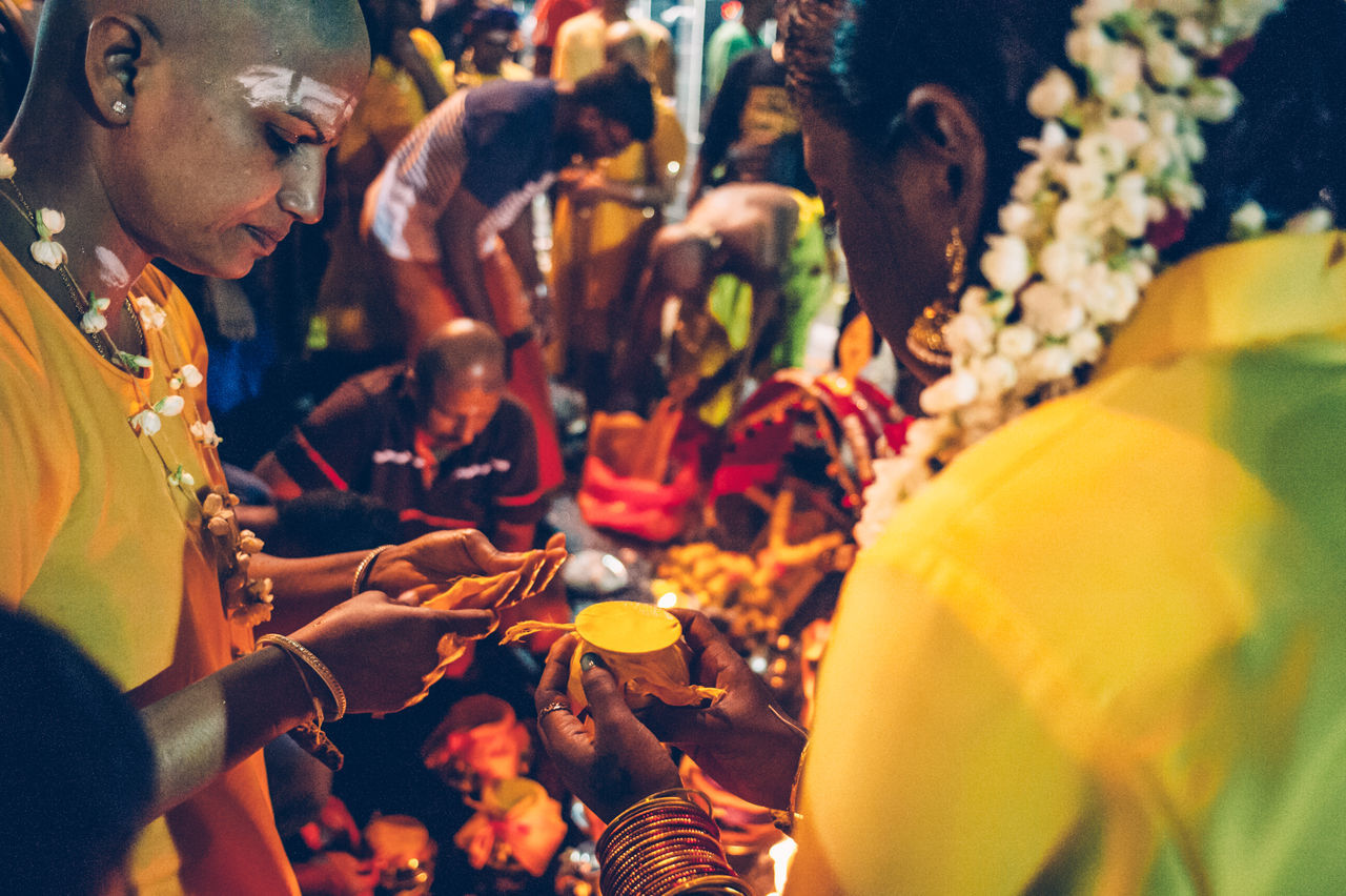 Batu Caves Close-up Devotees Focus On Foreground Hinduism Outdoors Photojournalism Religion Religious  Selective Focus Thaipusam2016 The Photojournalist - 2016 EyeEm Awards Travel Photography Yellow