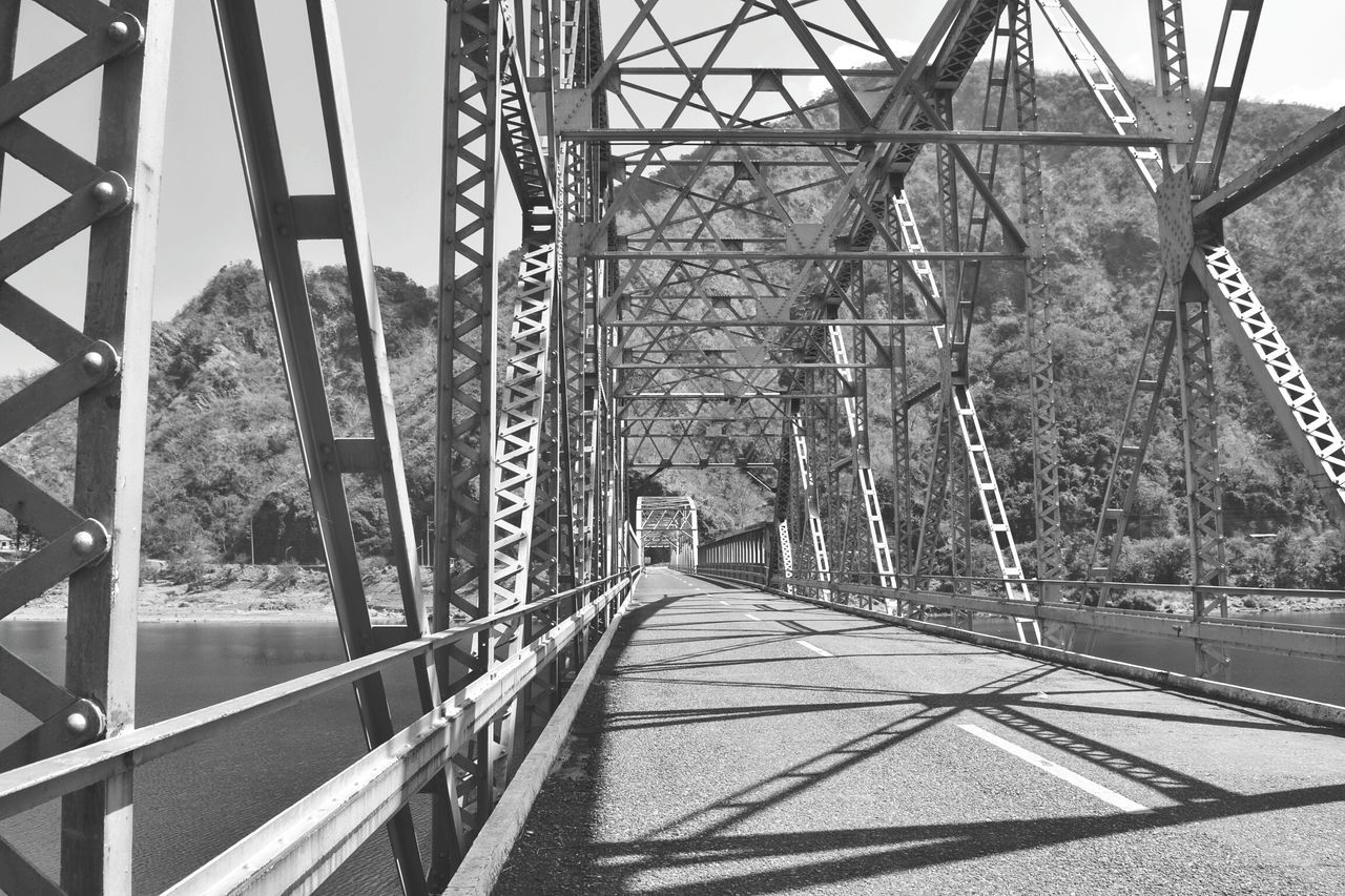 bridge - man made structure, connection, day, transportation, the way forward, built structure, metal, architecture, railroad track, no people, tree, outdoors, nature, sky