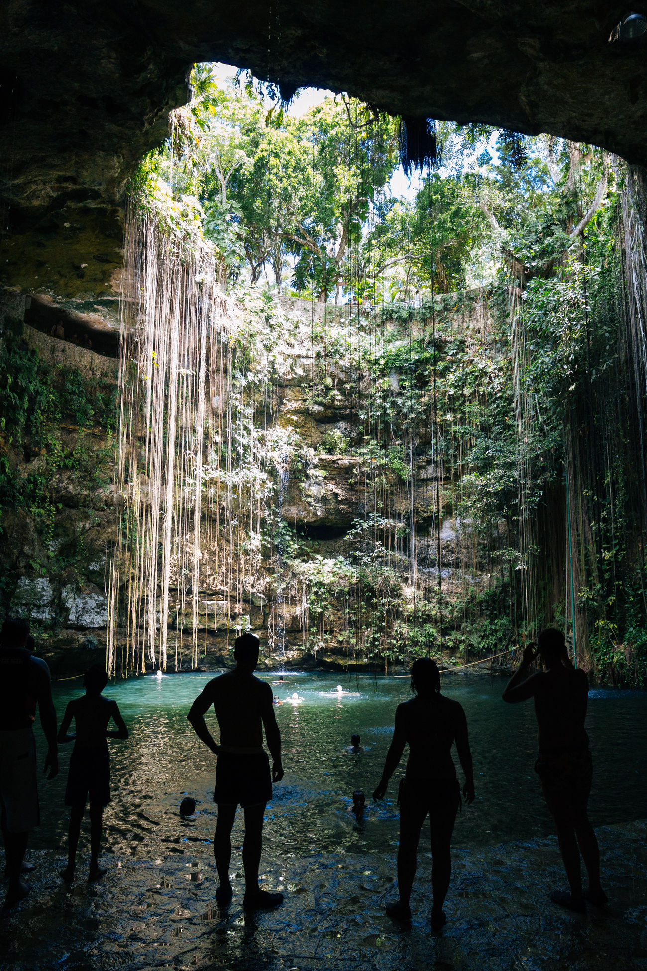 Cenote Ik-kil, Chichen Itza, Yucatan, Mexico Beauty In Nature Cave Cenote Cenote Ik Kil Cenotes Cueva Lifestyles Mexico Nature Outdoors People Real People Roots Silhouette Silhouettes Tree Two People Vacations Water Yucatan Mexico Yúcatan