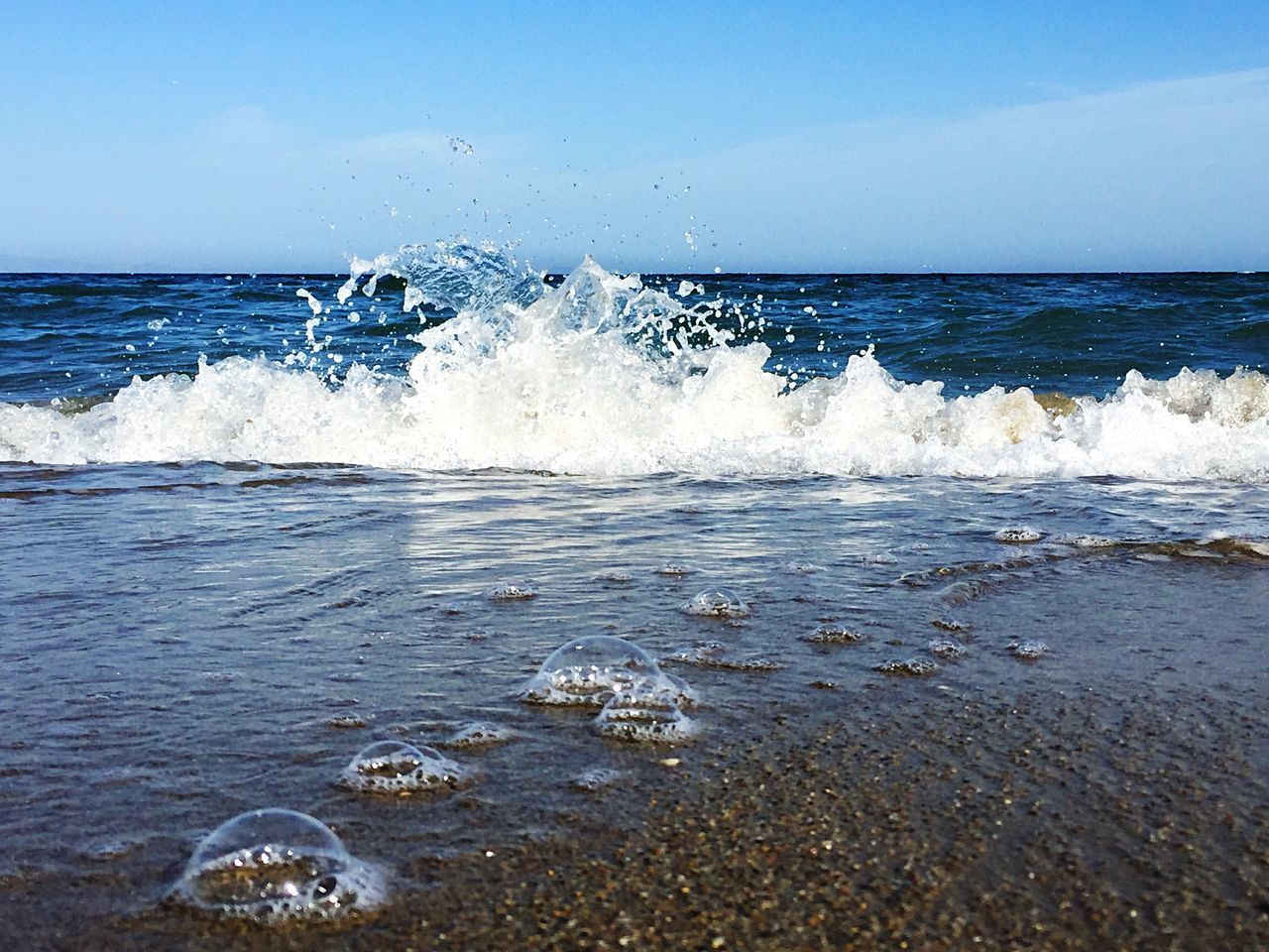 Sea Splashing Wave Water Waterfront Blue White Dancing Waves Bubbles On Sand Wet Sand Horizon Over Water Outdoors