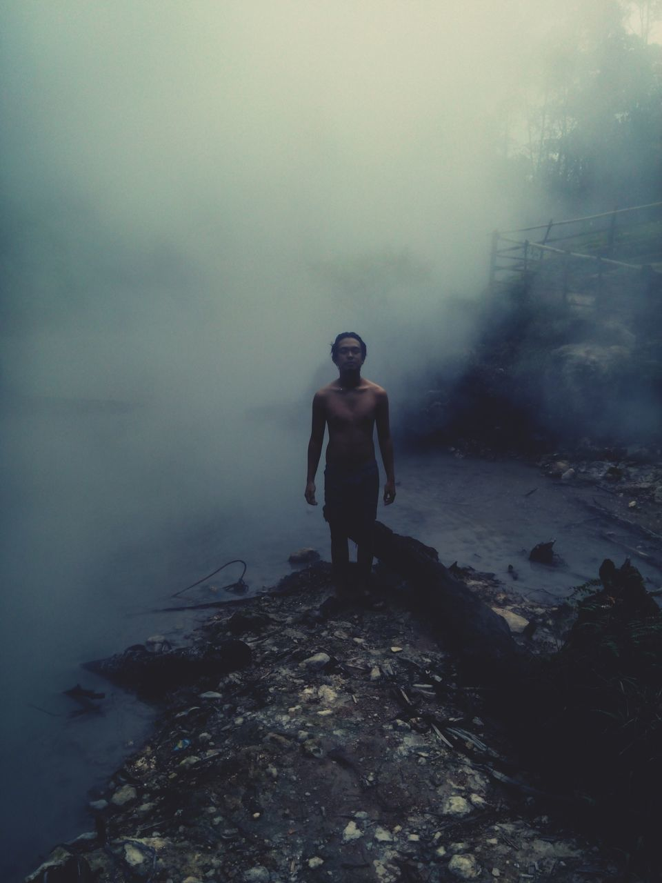 fog, full length, foggy, one person, real people, nature, standing, outdoors, hazy, day, young adult, water, beauty in nature, young women, sky, people