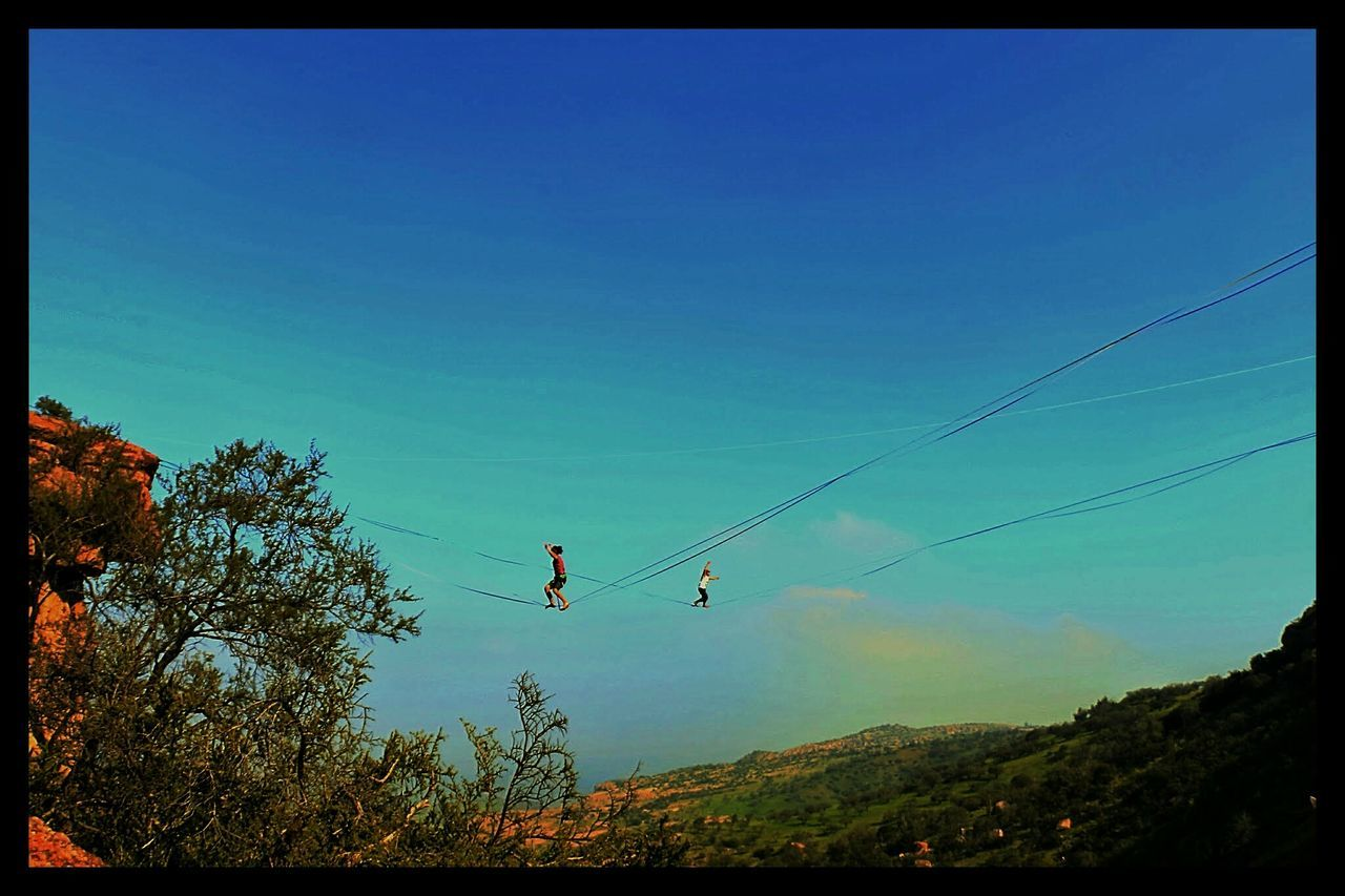 Slackline Walking Slackline Sport Highline Longline Walking Simple Things In Life Colors Colores Relaxing Nature Landscape Panoramic Air Green Sky Blue Blue Sky Colour Of Life Twoo Is Better Than One The Color Of Sport