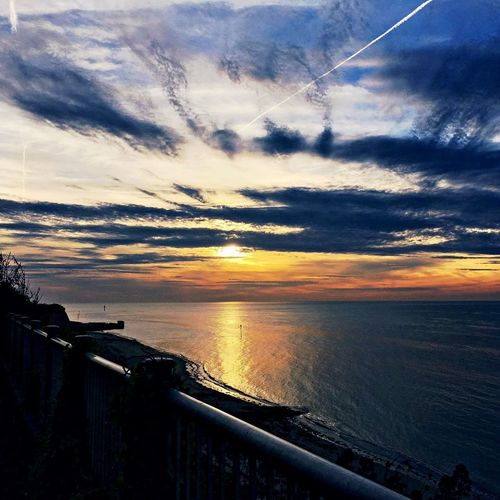 Sunset Sea Sunlight Reflection Dark Clouds Bluesky PhotographyMotion Water Beauty In Nature Sunsetphotography Orange Sky