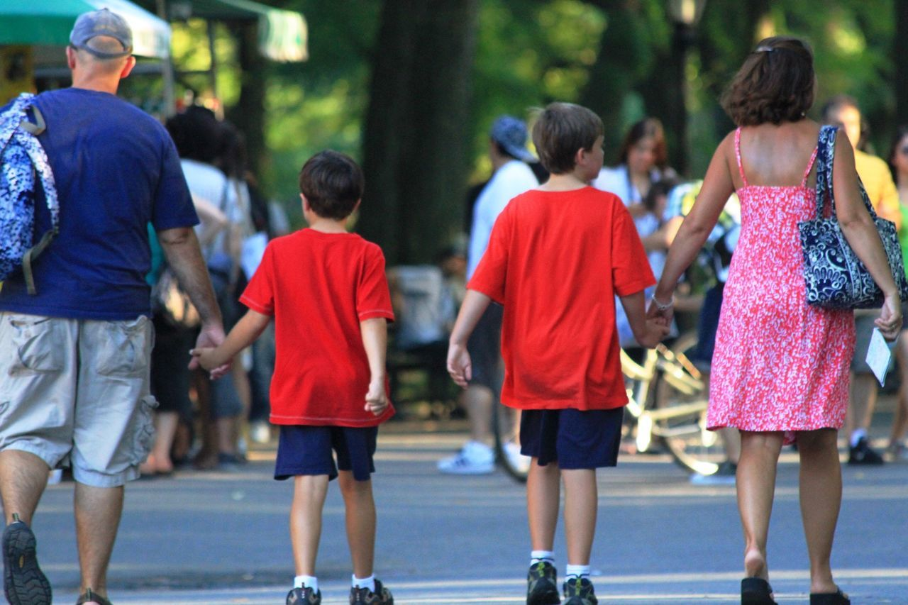 Family Walking Holding Hands Kids Family Vacation Central Park Mom And Dad Mom Dad And Boys Boys Park Urban Summer Horizontal People