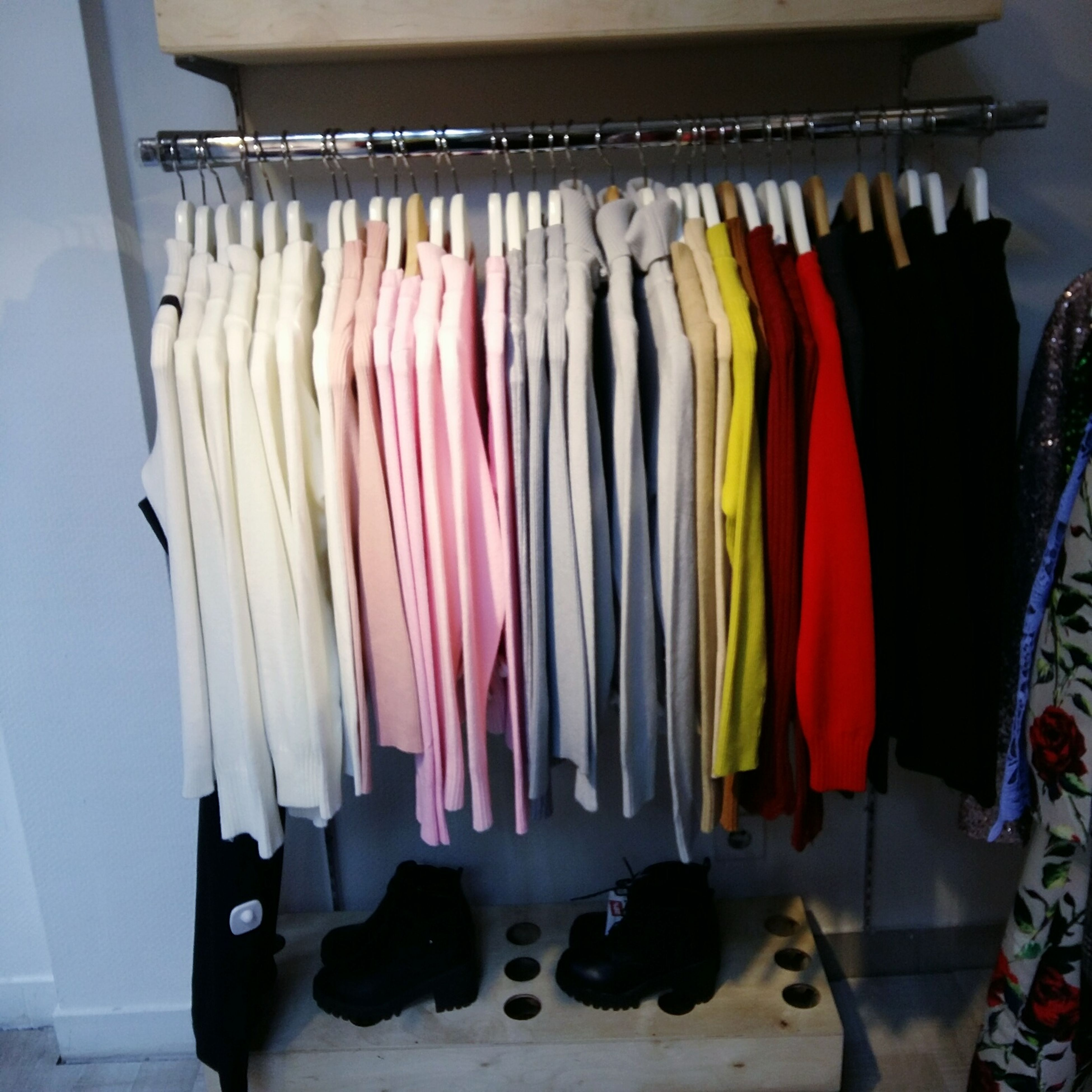 hanging, variation, multi colored, coathanger, clothes rack, choice, clothing, indoors, no people, large group of objects, in a row, neat, arrangement, day