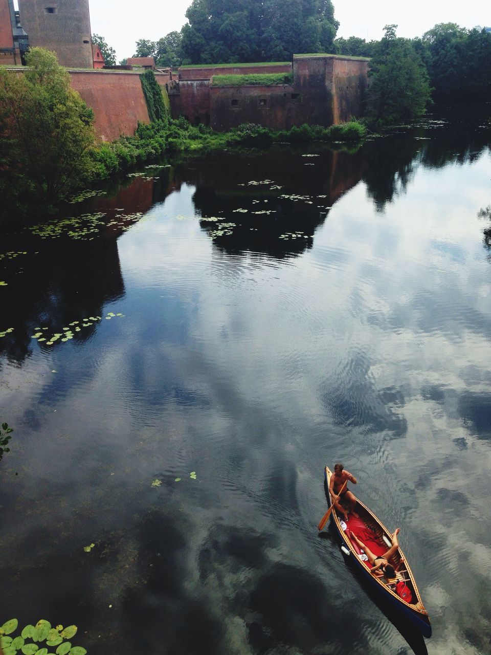 water, reflection, day, nature, outdoors, high angle view, tranquility, no people, building exterior, built structure, tree, architecture, beauty in nature, nautical vessel, sky