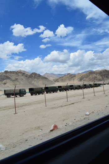 Driving outside of Leh, passing military colon. Adventure Car Window Views Day Driving Around Drivingshots Himalaya Himalayas India Indian Military Indian Military Vehicles Jammu And Kashmir Militarised Area Militarized Military Military Truck Roadtrippin' Sky And Clouds Travel