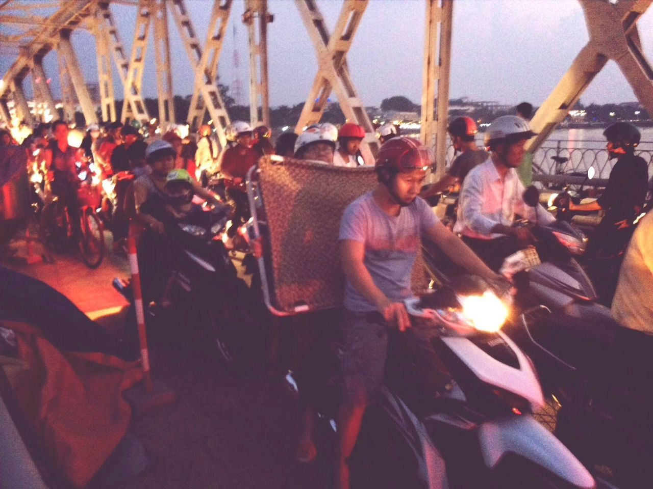 Heavy traffic across the Trường Tiền bridge in Huế Sunset Motorcycles Rush Hour Streetphotography
