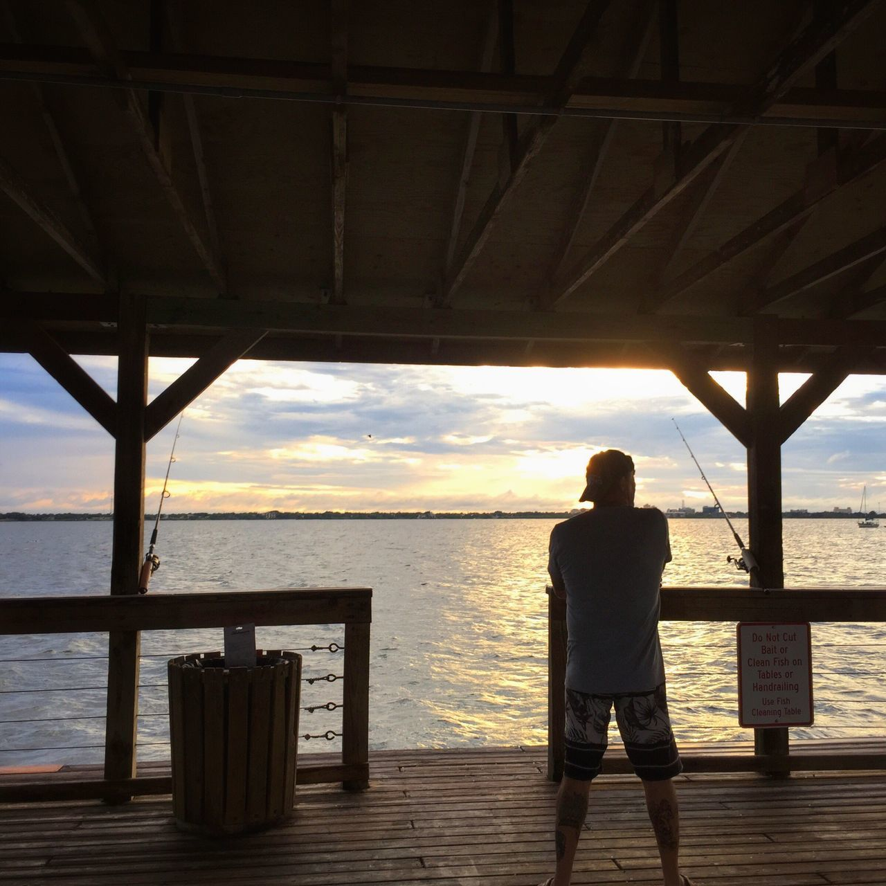 Watching his lines Fisherman Melbourne Beach, FL Indian River Lagoon Sunset Indian River Lagoon Melbourne Beach Pier Florida Sunset Fishing Pole Pier At Sunset Fishing Time