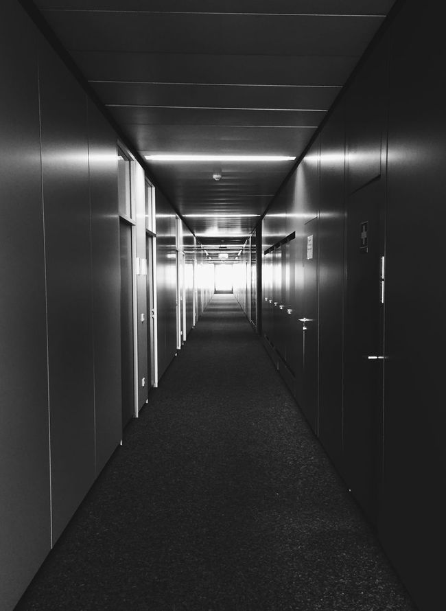 Light At The End Of The Tunnel Office Corridor Starting The Day Blackandwhite