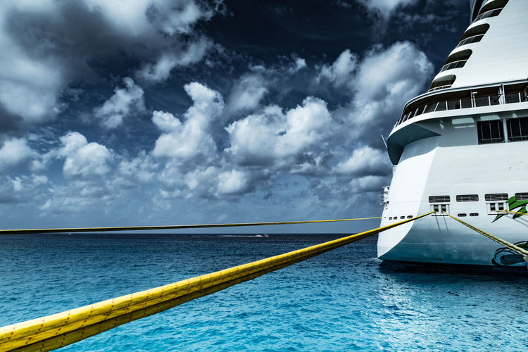 Architecture At Bayy Blue Boat Built Structure Cloud Cloud - Sky Cloudy Cropped Cruise Ship Day Mode Of Transport Nature Nautical Vessel Part Of Railing Rippled Sea Sea And Sky Sky Tethered Transportation Water Waterfront