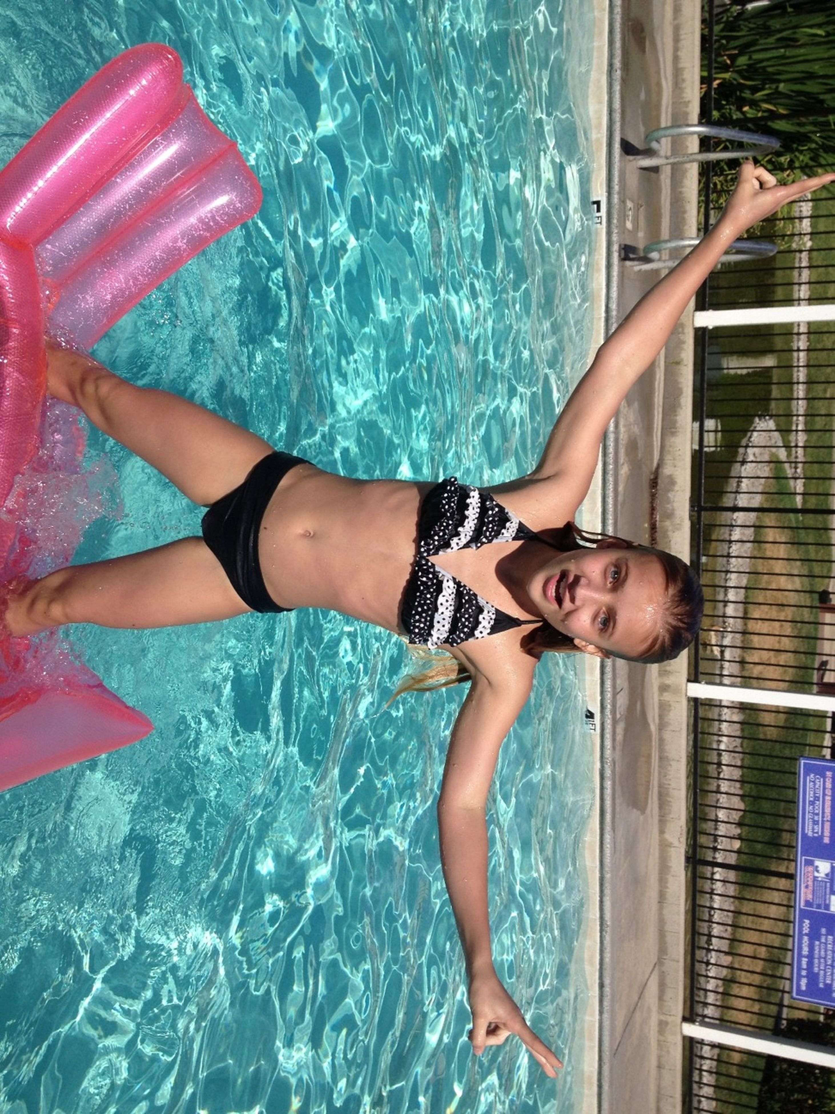 lifestyles, water, leisure activity, young adult, young women, swimming pool, full length, person, bikini, fun, dress, barefoot, casual clothing, standing, enjoyment, day