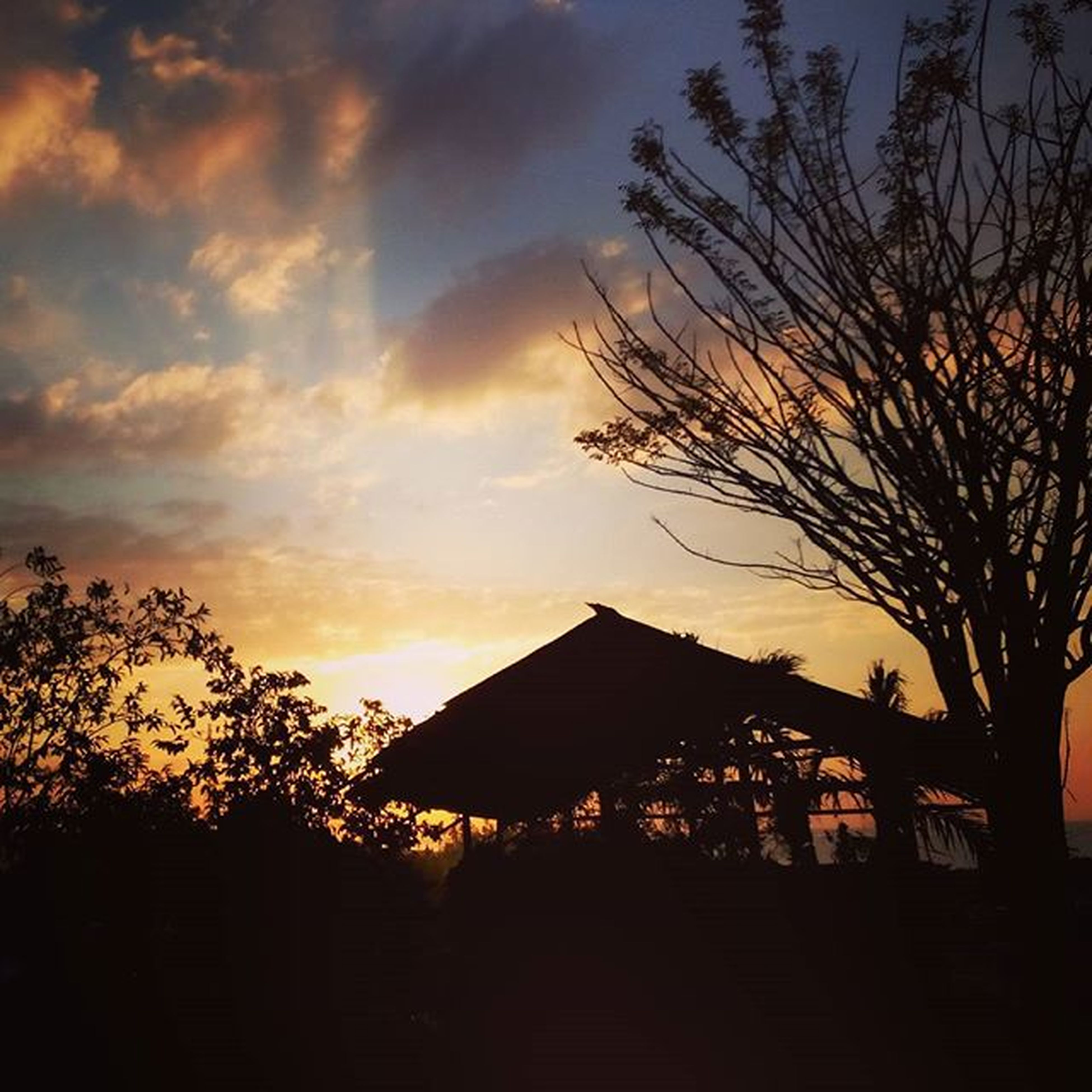 sunset, silhouette, sky, tree, built structure, building exterior, architecture, house, cloud - sky, bare tree, orange color, dusk, dark, nature, scenics, tranquility, beauty in nature, tranquil scene, cloud, outdoors