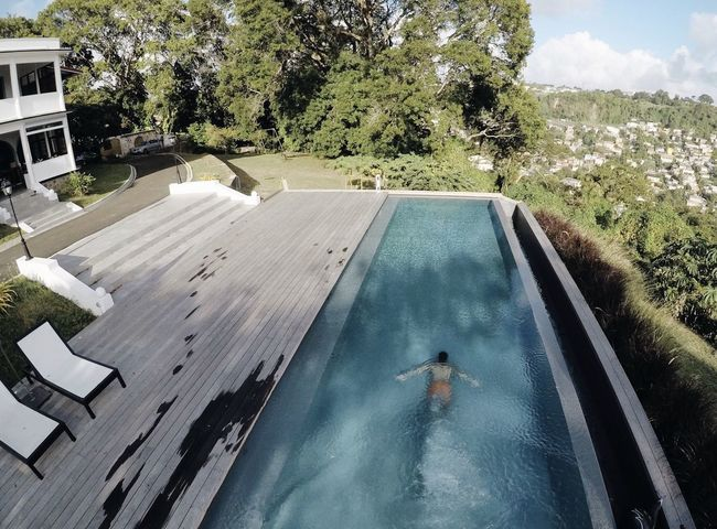 Beauty In Nature Day Full Length High Angle View Luxury Nature One Person Outdoors People Real People Sky Swimming Swimming Pool Tree Water EyeEmNewHere