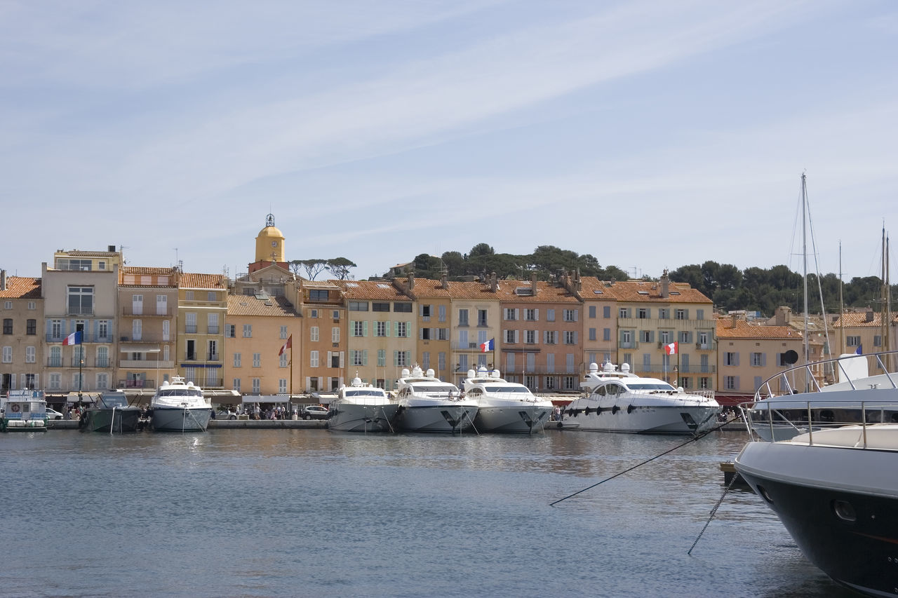 luxury yachts in the port of saint-tropez - french riviera, mediterranean sea Architecture Boat Building Exterior Cityscape Côte D'Azur Famous Place France Harbor Luxury Medieval Mediterranean  Mediterranean Sea Moored Nautical Vessel Port Provence Residential Building Saint Tropez Saint-Tropez Town TOWNSCAPE Travel Destinations Village Vintage Yacht