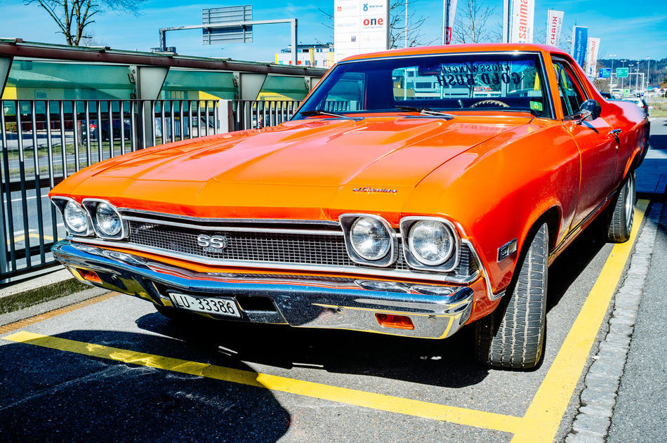 Car Chevrolet City Collector's Car Commercial Land Vehicle Day El Camino Industry Land Vehicle No People Orange Color Outdoors Red Speed Taxi Transportation Yellow Taxi