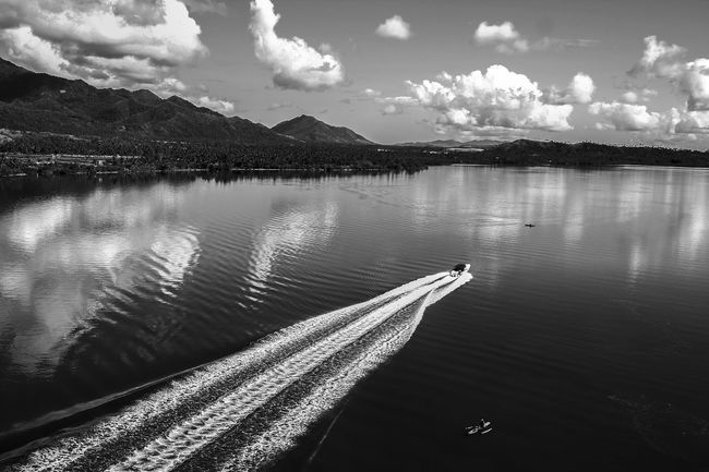 A speedboat cruises along San Juanico Strait which separates the islands of Leyte and Samar, in the Philippines Cloudy Eye4photography  EyeEm EyeEm Best Edits EyeEm Best Shots EyeEm Best Shots - Black + White EyeEm Best Shots - Nature EyeEm Gallery EyeEm Nature Lover EyeEmBestPics Leyte Leyte, Philippines Leytephilippines Mountain Range Outdoors Philippines Philippines <3 Philippines Photos Reflection Rippled Samar Sky Strait Visayas Water