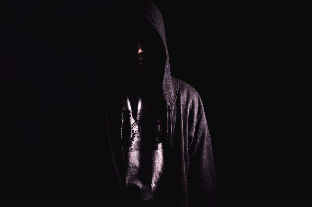 Beautiful stock photos of man, Black Background, Copy Space, Hood - Clothing, Hooded Shirt