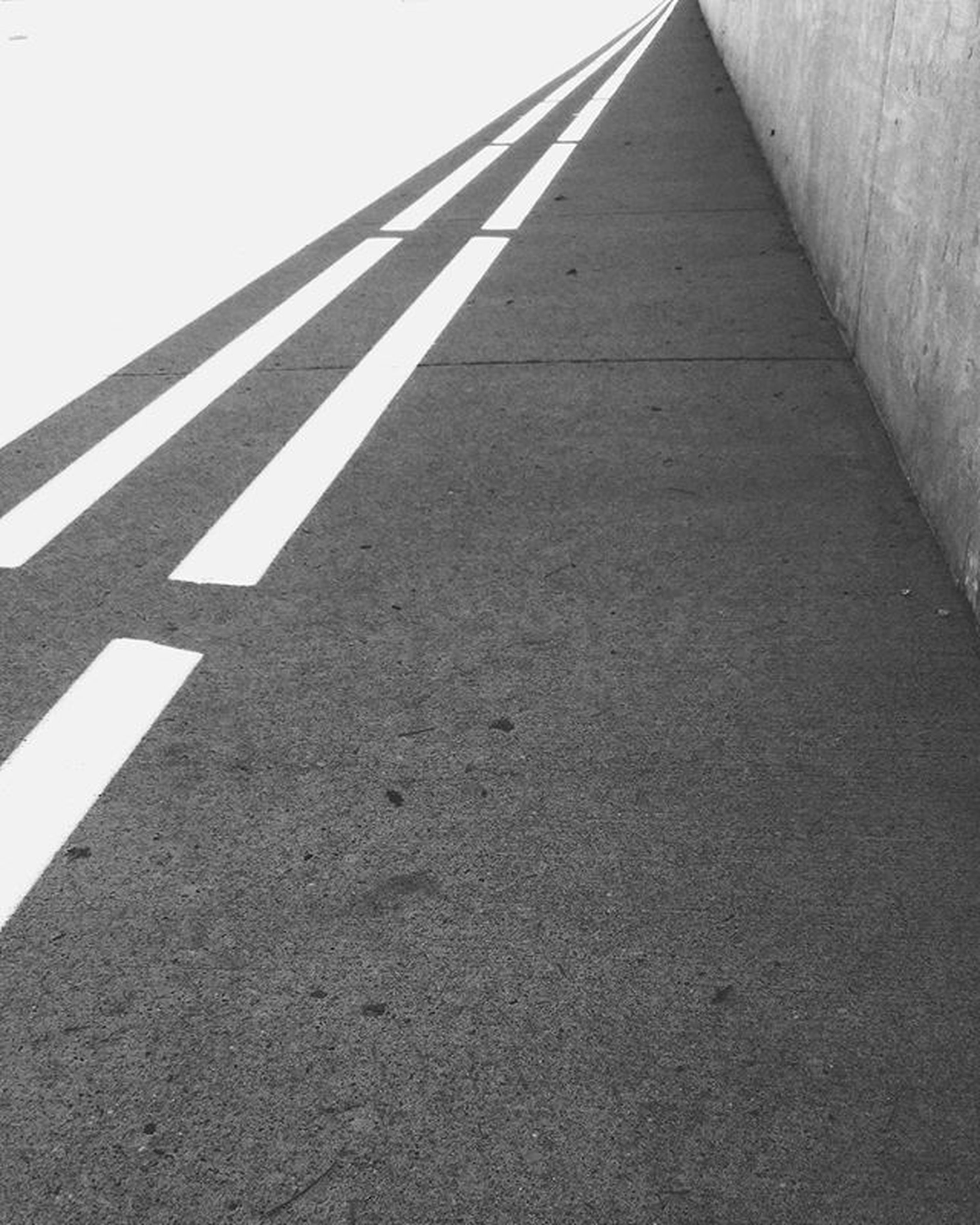 the way forward, road marking, diminishing perspective, built structure, architecture, transportation, road, asphalt, vanishing point, no people, outdoors, low angle view, day, guidance, street, sunlight, shadow, surface level, empty, direction