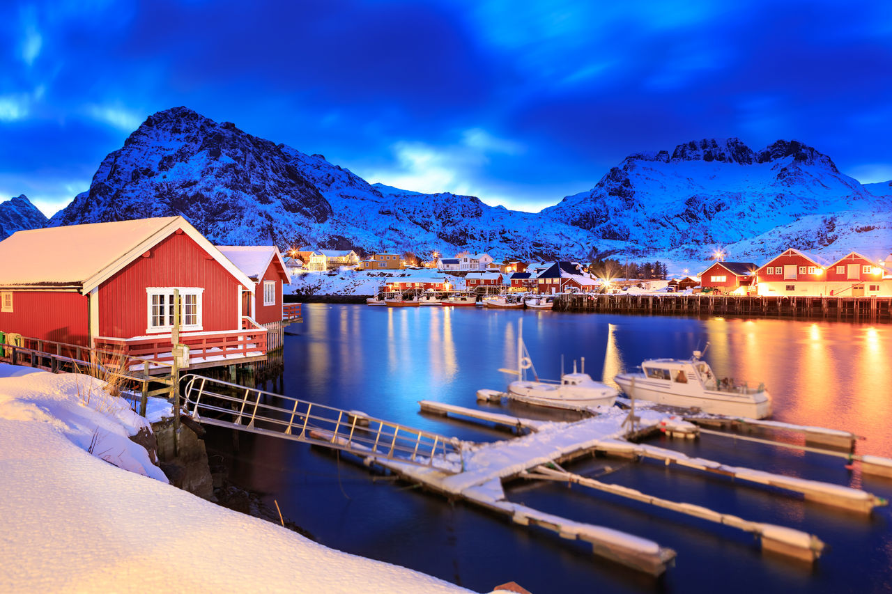 The fisherman village Sorvagen on Lofoten Islands by night, Norway Architecture Barents Sea, Lofoten Islands, Northern, Solvagen, Sorvagen, Town, Arctic, Atlantic, Coast, Cold, Europe, Fishing, Fjord, Harbor, Holiday, Ice, Landscape, Mountains, Nature, Night, Nordic, Nordland, North, North Sea, Norway, Norwegian, Ocean, Outdoor, Outd Beauty In Nature Blue Building Exterior Built Structure Cloud - Sky Day House Mountain Mountain Range Nature No People Outdoors Scenics Sky Snow Tranquility Water Winter