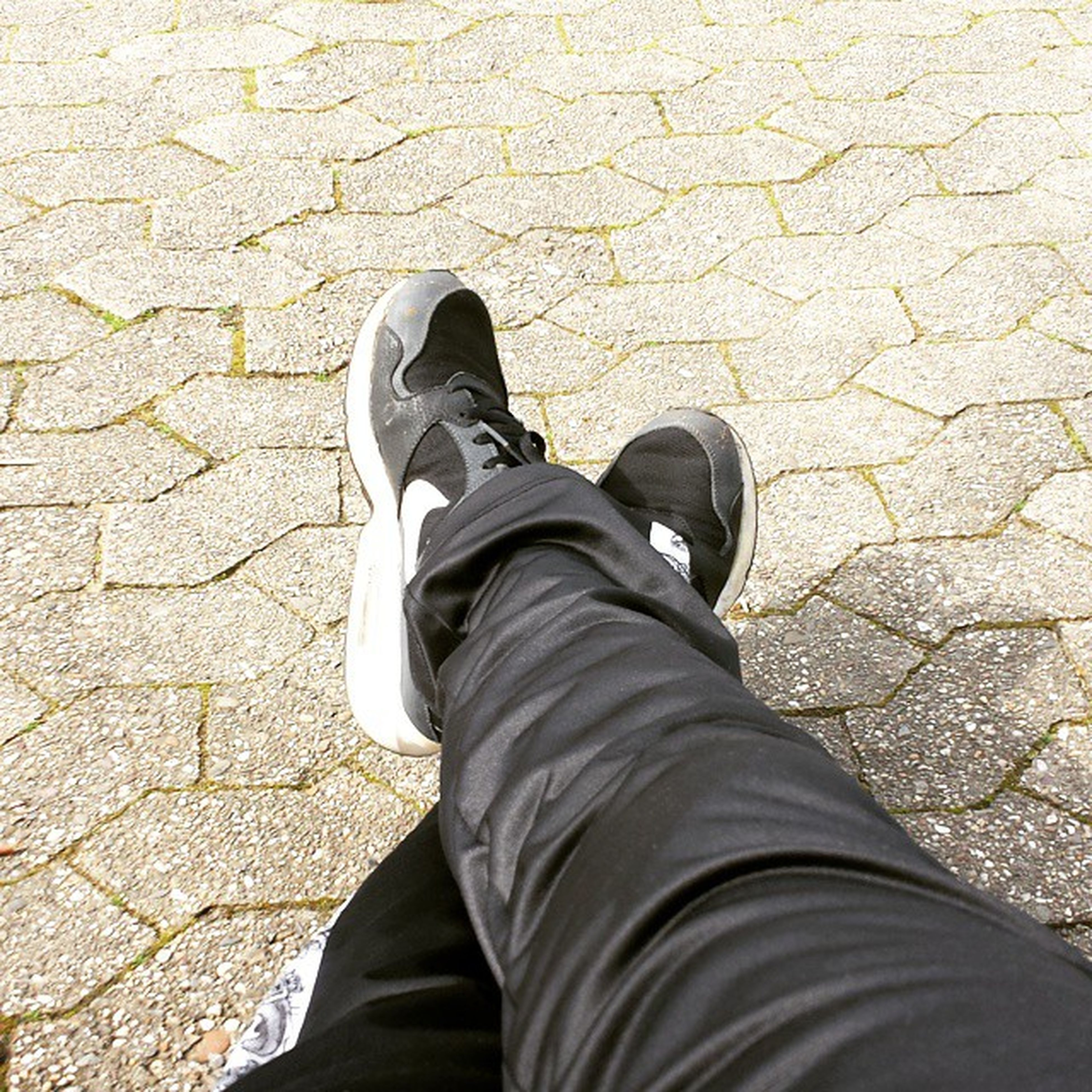 low section, person, personal perspective, shoe, standing, lifestyles, men, jeans, street, footwear, high angle view, leisure activity, casual clothing, human foot, unrecognizable person, day, outdoors