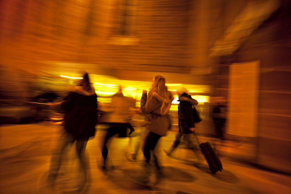 People walking down shopping street at dusk Adult Adults Only Blurred Motion City City Life Concept Crowd Illuminated Long Exposure Men Motion Night On The Move People Real People Shoppers Sidewalk Speed Sunset Togetherness Unrecognizable Unrecognizable People Unrecognizable Person Walking Yellow