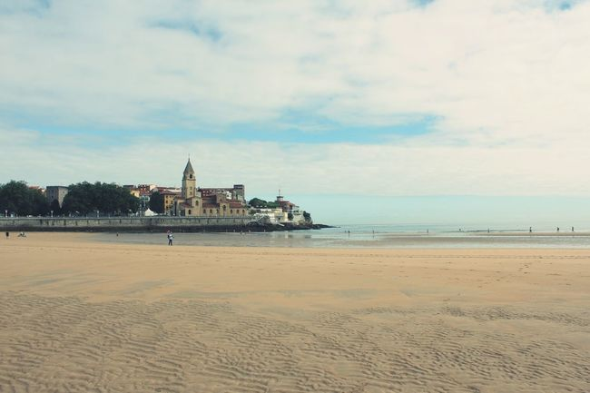 Gijon_asturias End Of Summer Beach Sea Sand Horizon Over Water Sky Shore Water Tranquil Scene Built Structure Tranquility Architecture Scenics Cloud Nature Coastline Calm Beauty In Nature Outdoors Cloud - Sky Blue Tranquility Exceptional Photographs Deceptively Simple