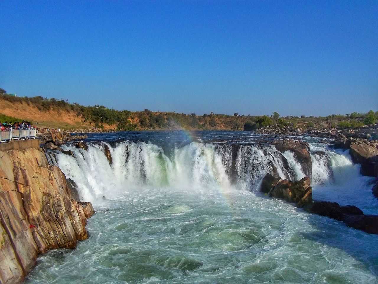 Jabalpur ,India Water Motion Long Exposure Outdoors Nature Beauty In Nature No People Blue Clear Sky Power In Nature Waterfall Sky Day Tranquil Scene EyeEm Waterfall Photography Beauty In Nature Nature Tranquility Rocks In Water Nature Photography Narmadariver Jabalpur Scenics
