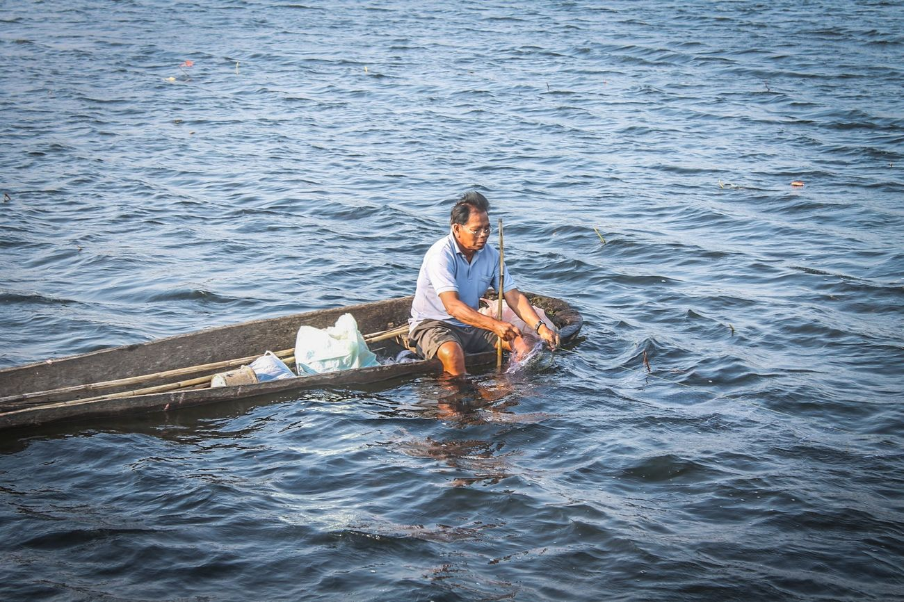 Isan catching fish Water Thailand Thaiculture วิถีไทย