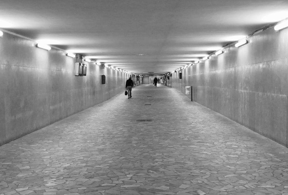 Architecture Black And White Blackandwhite Built Structure Ceiling Day Diminishing Perspective Eye4photography  Full Length Illuminated Indoors  Lighting Equipment Men One Person People Real People Rear View Street The Way Forward Tunnel Underground Urban Landscape Urban Scene Urban Style Walking